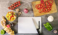 peppers and other ingredients to season pasta with copy space - stock photo