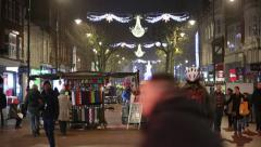 Christmas in England: festive street shoppers Stock Footage