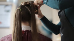 Stock Video Footage of Hairdresser makes hair girl