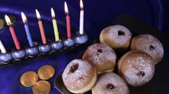 Hanukkah Sufganyot and candles Stock Footage