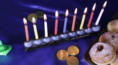 Top dolly shot over menorah and donuts - stock footage