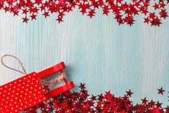 Aquamarine background with winter hot spices, mandarine and stars - stock photo