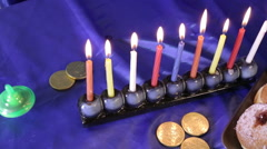 Hanukkah dreidel and menorah top shot Stock Footage