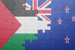 puzzle with the national flag of palestine and new zealand - stock photo