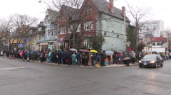 Hungry poor people lined up at Honest Ed's for free Christmas turkey Stock Footage