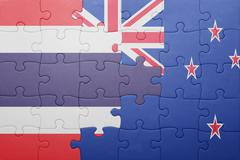 puzzle with the national flag of thailand and new zealand - stock photo