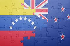 puzzle with the national flag of venezuela and new zealand - stock photo