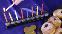Jewish traditional Lighting of Hanukkah menorah Stock Footage