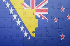Puzzle with the national flag of bosnia and herzegovina and new zealand Stock Photos