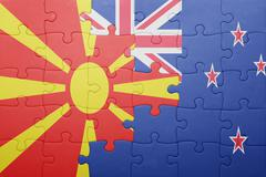 Puzzle with the national flag of macedonia and new zealand Stock Photos