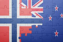 Puzzle with the national flag of norway and new zealand Stock Photos