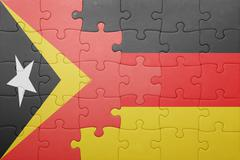 Puzzle with the national flag of germany and east timor Stock Photos