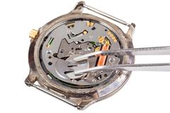 replacing battery in quartz watch isolated - stock photo