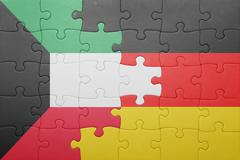 Puzzle with the national flag of germany and kuwait Stock Photos