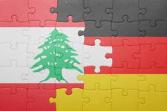 Puzzle with the national flag of germany and lebanon Stock Photos