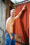 Sexy fashion portrait hot male model in stylish jeans with muscular body posing - stock photo
