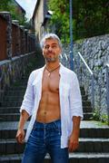 Sexy fashion portrait hot male model in stylish jeans and shirt with muscular - stock photo