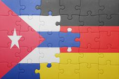Puzzle with the national flag of germany and cuba Stock Photos