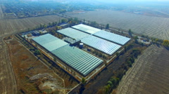 Flying high above the greenhouses, orangery Stock Footage
