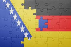 Puzzle with the national flag of bosnia and herzegovina and germany Stock Photos