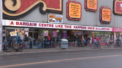 Toronto Honest Ed's store with people lined up for free Christmas turkey Stock Footage