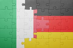 Puzzle with the national flag of italy and germany Stock Photos