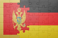 Puzzle with the national flag of montenegro and germany Stock Photos