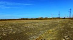 Flight over a field near a power line Stock Footage