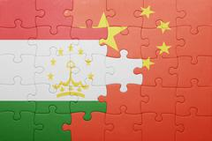Puzzle with the national flag of tajikistan and china Stock Photos
