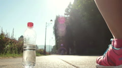 Young woman drinking a water after  jogging Stock Footage