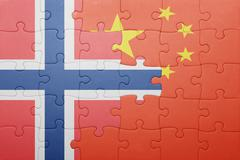 Puzzle with the national flag of norway and china Stock Photos