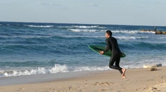 Sporsmen engaged in surfing in the Mediterranean Stock Footage
