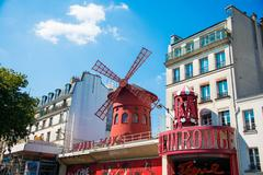 Paris - JULY 8, 2013:  Moulin Rouge Cabaret famous red mill on J Stock Photos