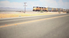A freight train in the desert advances towards the camera. Stock Footage
