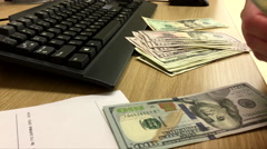 Woman counting US dollar inside HSBC bank Stock Footage