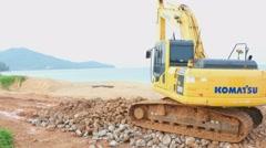 Excavator working on beach Stock Footage
