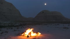 Campfire Burning Flames at Night Full Moon in Badlands Stock Footage