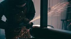 Welder Grinding Down Pipe. Stock Footage