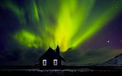 Beautiful Northern light over church Stock Photos