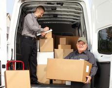 Group of delivery men near shipping truck. Stock Photos