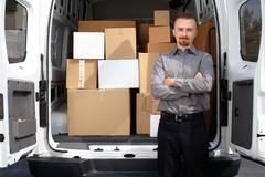 Young delivery man near truck. Stock Photos