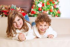 Happy kids in Christmas eve - stock photo