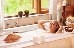 Woman relaxing at spa resort Stock Photos