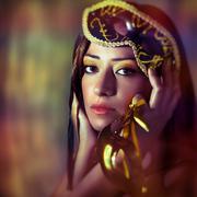 Woman wearing venetian mask - stock photo