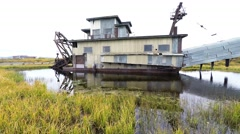 Historic Abandoned Gold Mining Dredge at Nome Alaska Stock Footage
