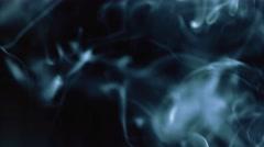 Whisps of Blue Smoke Against Black Background - stock footage