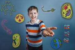 Teen boy laughs and holds out his hand forward icons biology edu Stock Photos