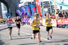 LONDON - APRIL 13: Unidentified men run the London marathon on April 13, 2014 Stock Photos