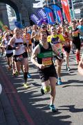 LONDON - APRIL 13: Unidentified men run the London marathon on April 13, 2014 Stock Photos