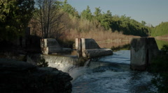 Static Shot of Waterfall and an Old Dam. Stock Footage